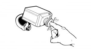 finger stuck into a surveillance camera