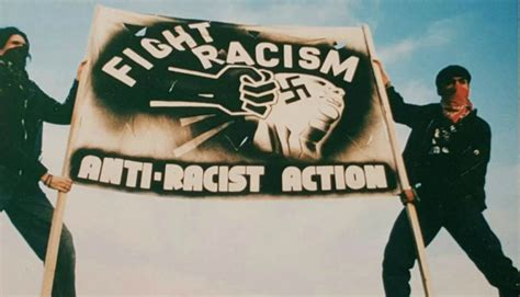 Anti-Racist Action banner with a fist punching a face that has a swastika on it. Banner reads: fight racism, anti-racist action
