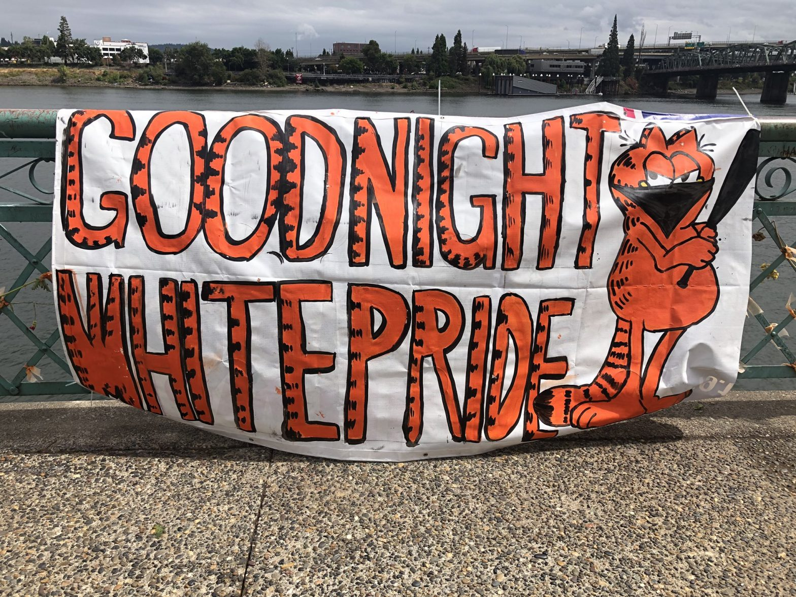 """Banner with Garfield holding a bat, reads """"Goodnight White Pride"""""""